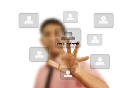 Asian businessman pushing social network. Stock Photo - 10994192