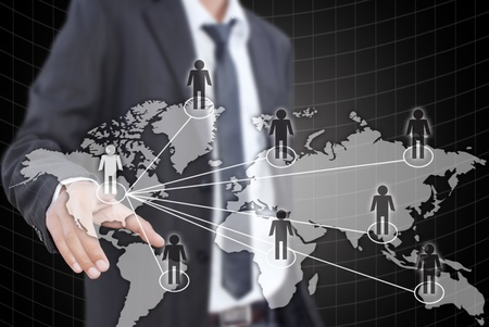 Asian businessman putting people social network. Stock Photo - 10994276