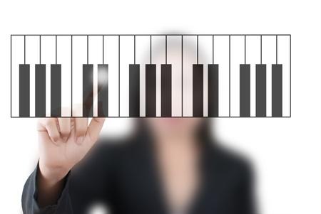 Asian business lady pushing keyboard piano. Stock Photo - 11071736