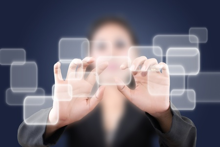 Asian business lady pushing button on the whiteboard. Stock Photo - 11071764