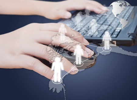 Hand click mouse with social network. photo