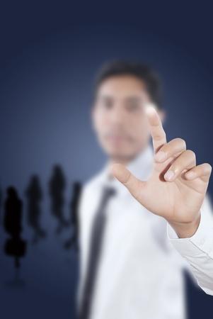 Asian businessman pushing on the whiteboard. photo