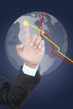 Business hand pushing graph and globe. photo