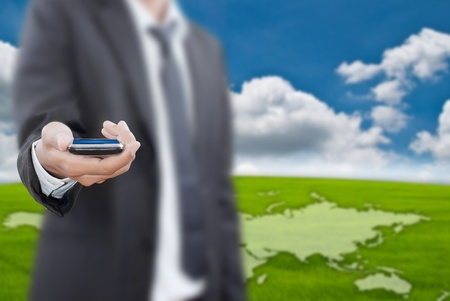 ringtones: Businessman putting touch screen mobile phone.