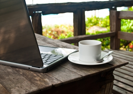Coffee cup and laptop for business. photo