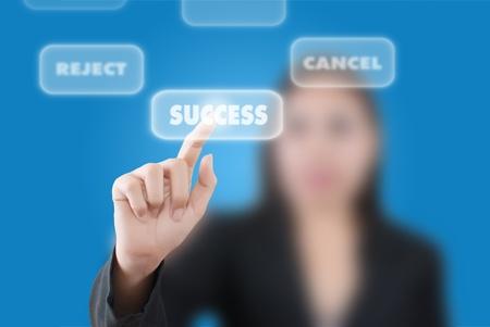 Business woman pushing success word. photo