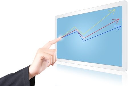 Hand pushing up graph on the tablet screen. photo