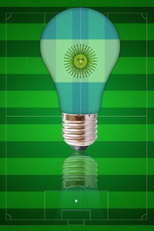 afflatus: Light bulb with Argentina flag on soccer field.