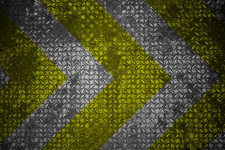 Yellow and black warning sign on steel texture. Stock Photo - 11500899