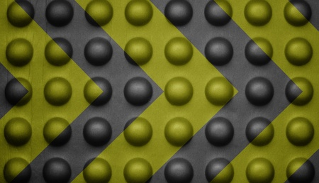 Yellow and black warning sign on bubble texture. photo