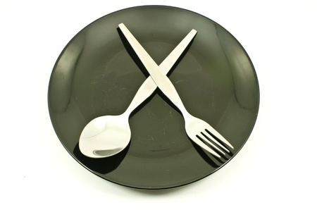 Dish and spoon isolated. photo