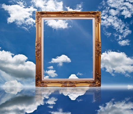 black picture frame: Photo frame on the blue sky field. Stock Photo