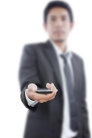 Businessman putting touch screen mobile phone. photo