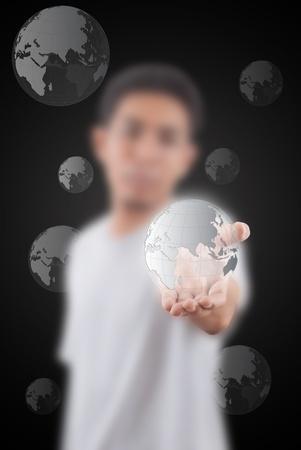 Asian man give world map globe. Stock Photo - 11500995