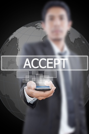 Businessman putting mobile with accept word. photo