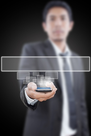 Businessman putting mobile with button. photo