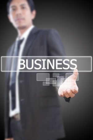Businessman pushing business word. Stock Photo - 11501063