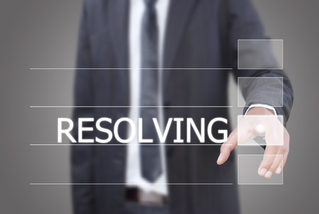 resolving: Imprenditore spingendo Risoluzione di parola su una interfaccia touch screen. Archivio Fotografico