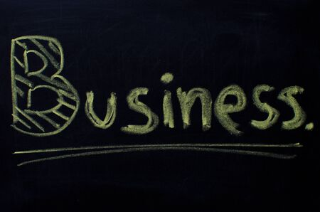 combined effort: Business word handwritten with chalk on a blackboard.