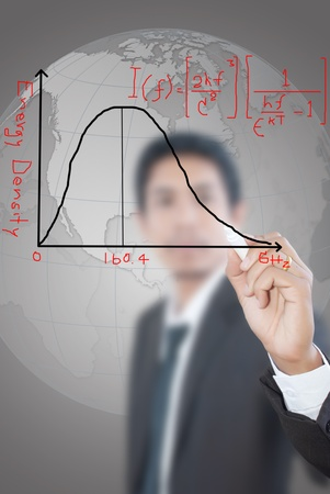 Asian teacher writing scientific formula on the whiteboard. photo
