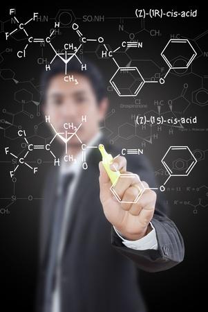 teacher writing scientific formula on the whiteboard. photo