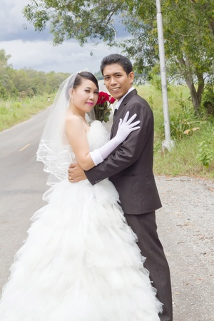Asian man and woman in wedding concept. photo