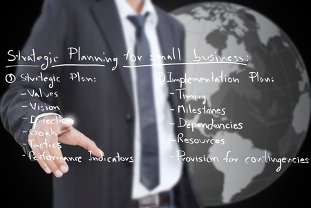 company vision: Businessman pushing business strategic planning on the whiteboard. Stock Photo