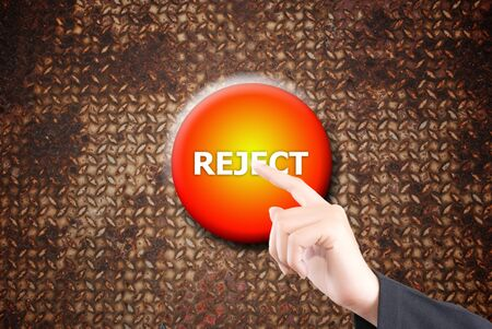 Hand pushing reject button on the steel texture. Stock Photo - 11819686