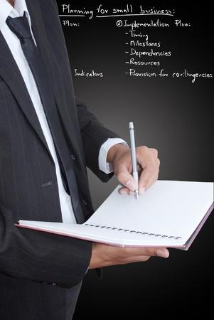 Businessman write on notebook. Stock Photo - 11819761