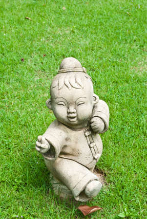 Chinese statue on the grass field in the temple. photo
