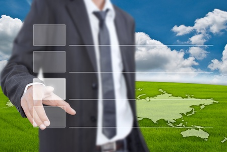 e work: Asian businessman pushing button on the blue sky field. Stock Photo
