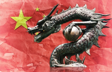 festival scales: Chinese style dragon statue on China flag.