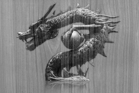Dragon statue on the wood texture. Stock Photo - 11943980