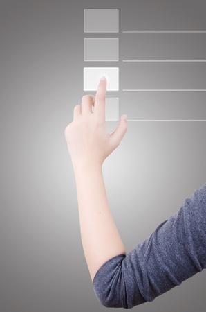 pushing the button: Por negocios presionando el bot�n en la pantalla t�ctil. Foto de archivo