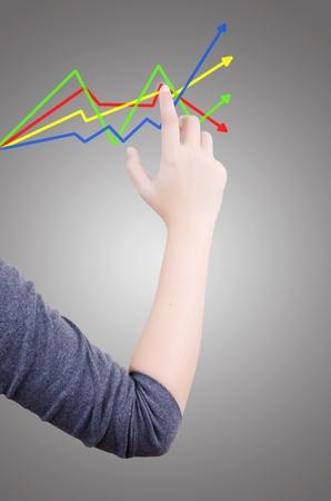 Business hand pushing graph photo