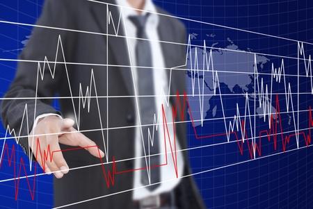 Businessman pushing graph for trade stock market on the whiteboard. Stock Photo