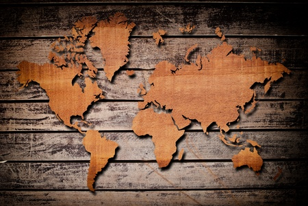 World map carving on wood plank. Stock Photo - 12715276