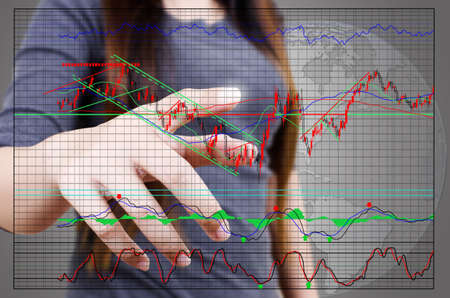 Business lady pushing finance graph for trade stock market on the whiteboard. photo