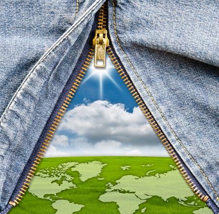 unzipped: Closeup of zipper with blue sky field in blue denim