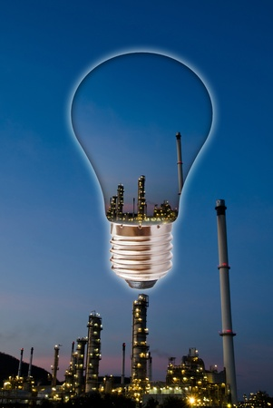 Petrochemical industry on sunset dark blue sky with light bulb  Stock Photo - 12900482