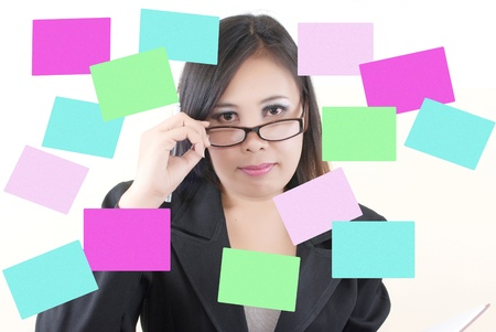 Business lady thinking with sticky note  photo