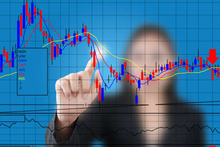 Business lady pushing finance graph for trade stock market on the whiteboard  photo