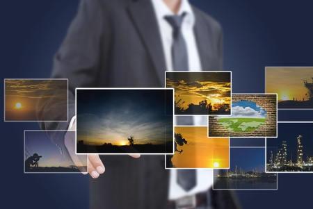 Businessman pushing many image button on the whiteboard  Stock Photo - 13015192