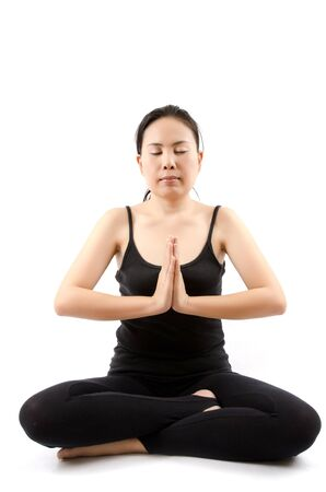 Young Asian woman doing yoga exercise  photo