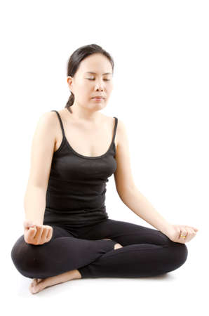 Young Asian woman doing yoga exercise  Stock Photo - 13015360