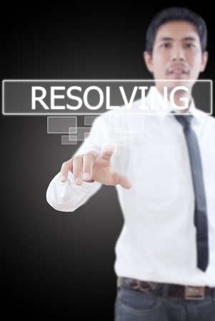 resolving: Businessman pushing Resolving word on a touch screen interface