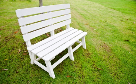 White wooden bench in the park for rest and relax  photo