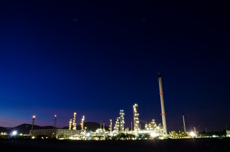 Petrochemical industry on sunset dark blue sky