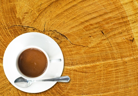 Coffee cup on the wood texture  photo