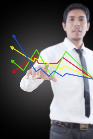 Businessman pushing finance graph for trade stock market on the whiteboard Stock Photo - 13247168